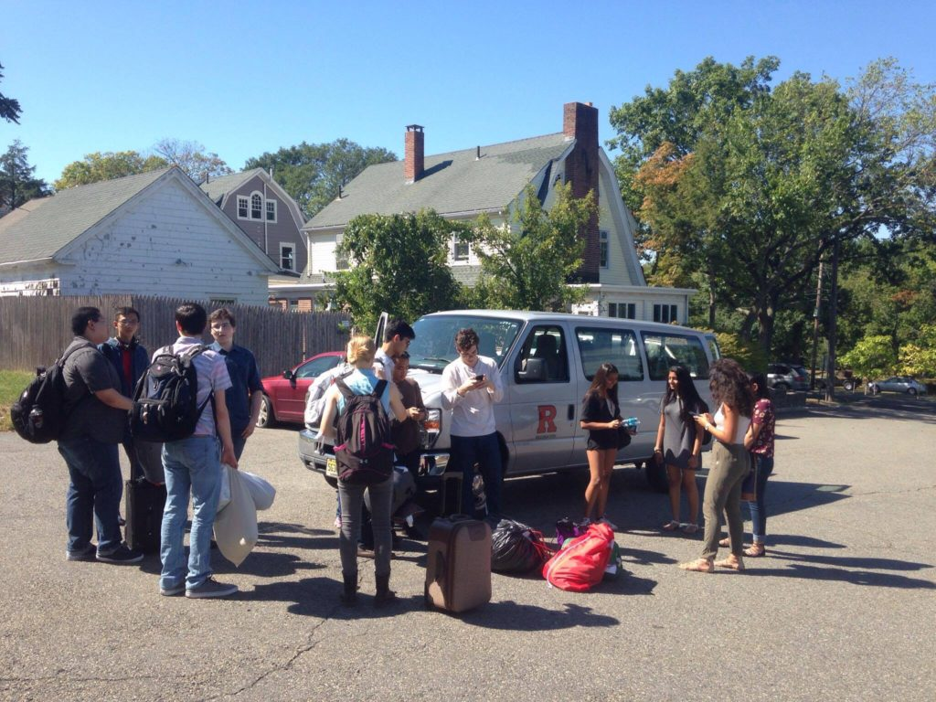 Novice and Varsity members wait outside the RUDU Van before heading out to Swarthmore, PA