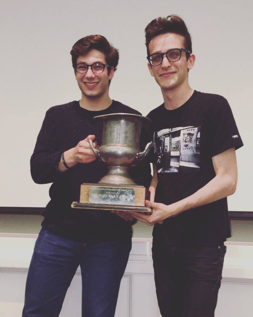 L-R Max Albert '19 and Pasha Temkin '18 hold up the John Harvard Cup, the most prestigious award at APDA's most contested regular tournament